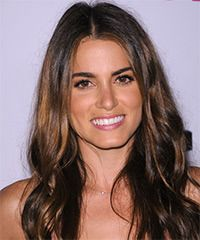 Nikki Reed Hairstyle-  These long locks have only long layers cut around the edges to lighten the length allowing for soft movement through the mid-lengths to ends. This is a low fuss hairstyle best suited to frame a round face. Regular trims is needed to maintain a healthy look and feel and prevent split ends.