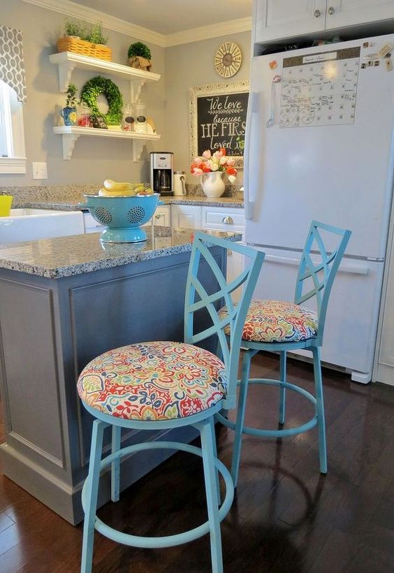 DIY upcycled kitchen stools.  What a difference some spray paint and fabric can make!