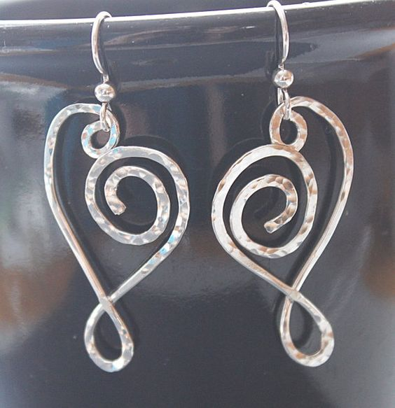 Sterling silver heart earrings. Hammered to give a beautiful texture.  $ 20.00  by Jewelrybeyondthesea.  Click on the picture to start your early holiday shopping.