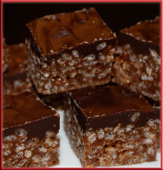 Mars Bar Rice Krispies Squares is a favorite of my Mother-in-Laws, one that is super easy and that everyone loves.  I mean it has chocolate bars in it; need I say more?! :) Ingredients 1/2 cup butt...