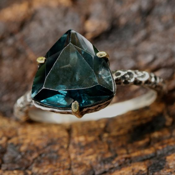 London blue topaz triangle faceted ring in silver bezel and brass prongs setting with sterling silver texture oxidized band