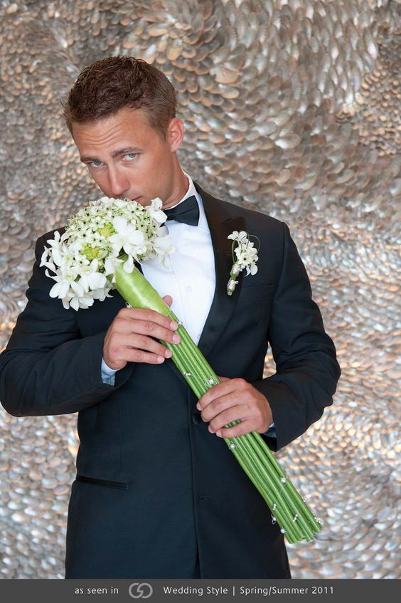 White Hawaiian dendrobium orchids and ornithogalum wrapped in green satin ribbon with strands of pearls. Boutonniere: White dendrobium orchid and ornithogalum with steel grass loops wrapped in silver beaded wire with pearls. @grace_ormande @wedding_style: