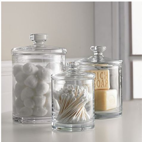 You could easily find old apothecary jars at antique stores and use them for easy, interesting bathroom storage solutions