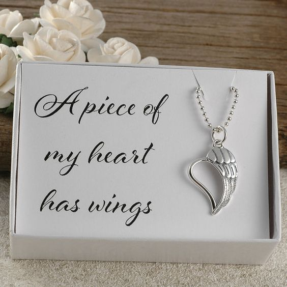 A sterling silver heart/wing necklace. This comes in a gift box with a card that reads A piece of my heart has wings. Miscarriage jewelry, stillborn, stillbirth, sids, Mom, Dad, Brother, Sister, Friend, Aunt, Uncle, Baby loss, bereavement jewelry, memorial, in memory of, remembrance