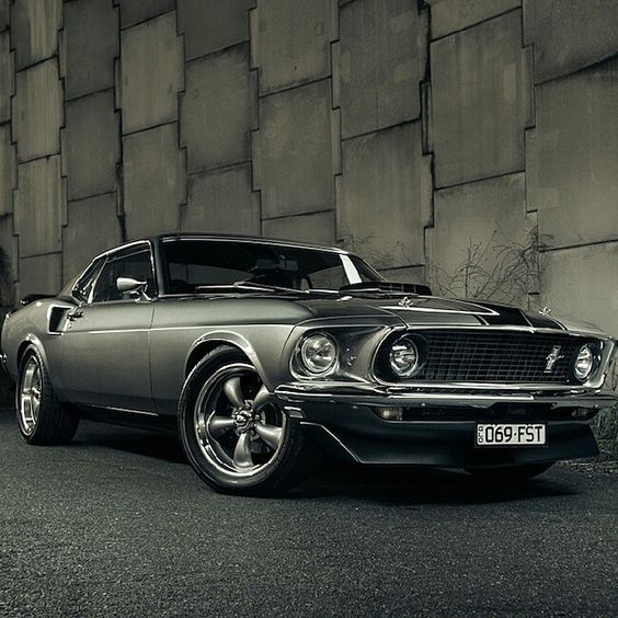 1969 Ford Mustang Fastback i want one of these some kind of bad along with a jacked up truck