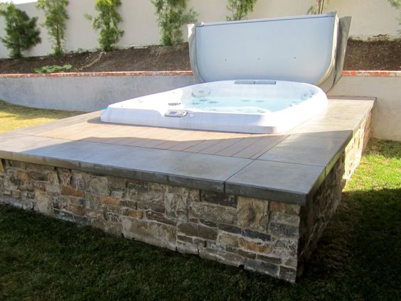 Interesting way to surround a hot tub like the low for Low profile bath tubs