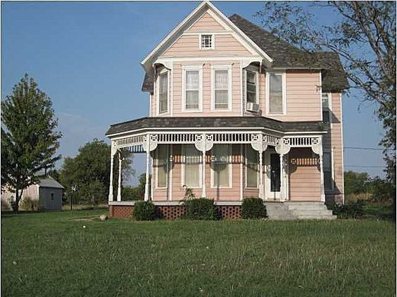 Two story victorian style home with large covered porch for Double storey victorian homes