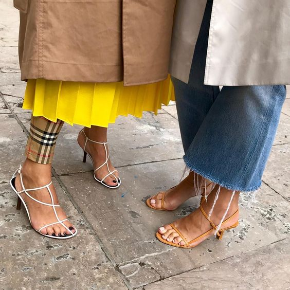 Naked sandals, or floss heels, have been all over Instagram. Read more about the popular footwear trend that'll be everywhere come summer, and shop these thin-strapped shoes here.