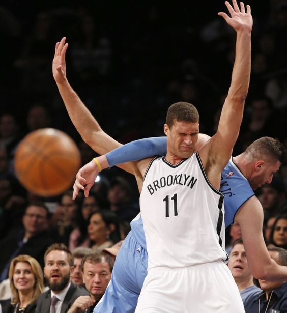 Brooklyn Nets center Brook Lopez (11) gets tangled up with Denver Nuggets center Jusuf Nurkic (23) in the first half of an NBA basketball game, Monday, Feb. 8, 2016, in New York. (AP Photo/Kathy Willens)