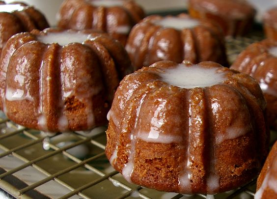 Gingerbread Bundts with Cinnamon Glaze. You'll need: 2 1/4c all-purpose flour, 1/2tsp baking soda, 1/2tsp salt, 1/2tsp allspice, 1/2tsp ground cloves, 1/2tsp ground nutmeg, 1tsp cocoa powder, 1tsp ground cinnamon, 2tsp ground ginger, 1stick melted then brought to room temp. unsalted butter, 3/4c dark molasses, 3/4c sugar, 1 large egg, 1/2c buttermilk, 1/2c whole milk.