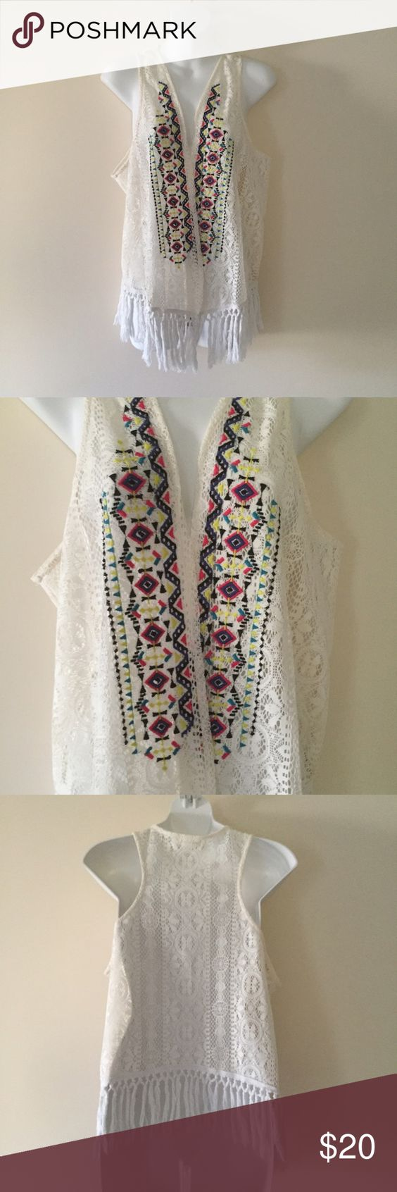 Embroidered vest with fringe Cute, throw on vest with fringe on the bottom. Perfect for festival season. Marked as L/XL, but would fit fine on a range of sizes.   Brand is Love on a Hanger from Nordstrom    Embroidered vest with fringe love on a hanger Tops