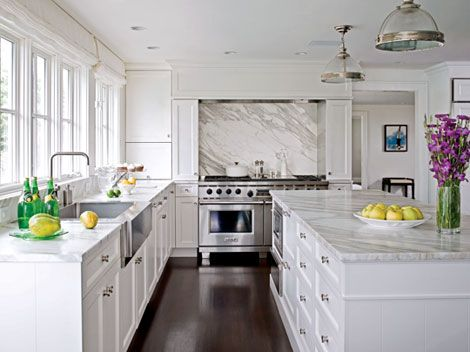 Calacatta marble countertops and backsplash give this white .