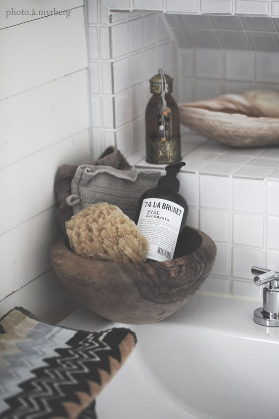 Bathroom Details: Moroccan oil bottle and natural sponge - I wish my home were this well styled.: