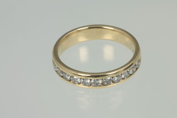 This is a 14kt yellow gold diamond channel set ring. Contains 11 Diamonds roughly 2.2mm in size. Stamped 14kt. http://rekitch.com/?wpsc-product=14kt-yellow-gold-diamond-channel-set-ring-size-5-14 $250.00