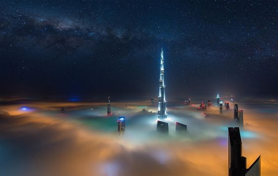 dubai at night above the clouds photo
