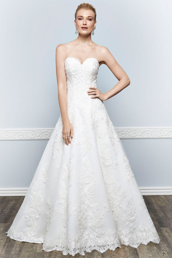 Wedding gown by Kenneth Winston.