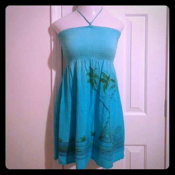Cute Island halter dress Pretty blue island halter dress with palm trees & bedazzled jewels  Size small  good condition only flaw is halter strap no biggie  Fun & flowy.  throw over a bikini pleasure pier  Dresses