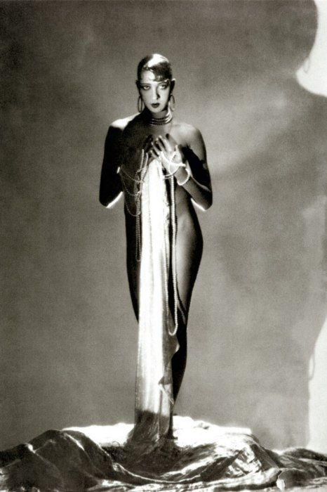Dripping in pearls and not much else, stage siren Joséphine Baker, photographed here by George Hoyningen-Huene for Vanity Fair,: