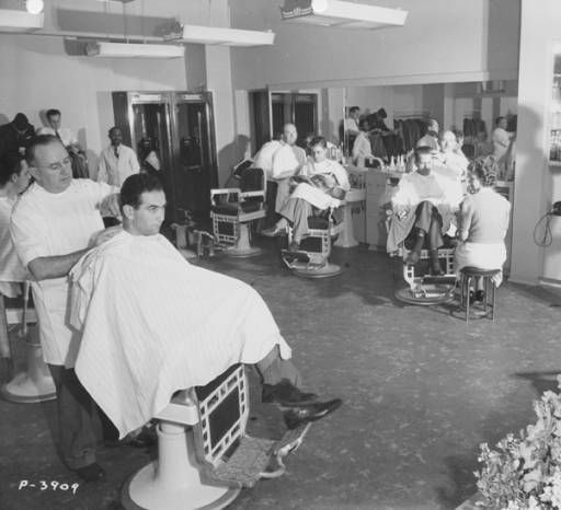 """Max Rauch, Manager of the Airport Barber Shop at the Hollywood-Burbank Airport. Coralie Hewitt Tillack remembers him as """"...barber extraordinaire from 1941 until 1972, and confidant of clientele who came to the terminal for a haircut, a shave, and Max's special type of therapy, the art of listening."""" Coralie Hewitt Tillack Collection. San Fernando Valley History Digital Library."""