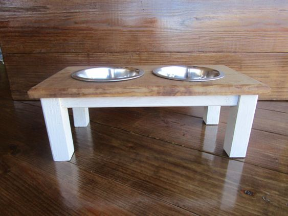 This is our version of an awesome dog bowl stand designed to look like a farm house table. This is for a small to medium sized dog, even