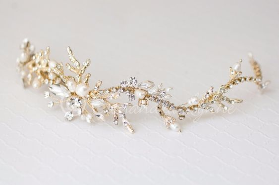 For the beach going bride this wedding headpiece is designed with crystal dotted coral branches, marquise crystals and sprays of freshwater pearls. It could be worn as a headband/tiara fashion or acro