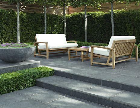 Grey Paved Backyard With Hedge Gardens Pinterest