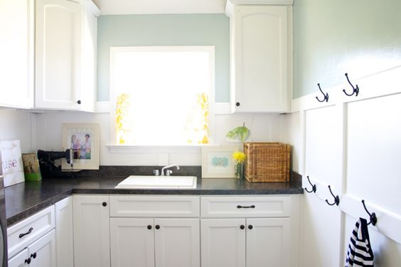 black counters with white cupboards