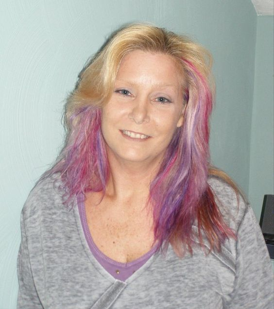 I dye my hair pink and purple every Fall in honor of breast cancer awareness.