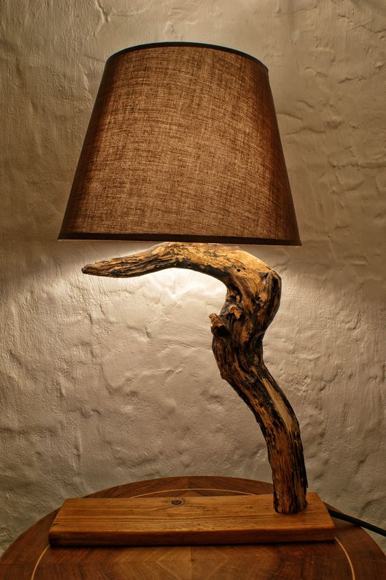 Luxurious and very unusual wooden lamp made of hawthorn wood.     Why is it Halloween lamp? It is because no other lamp can have better reputation than the lamp whose wood is used to kill vampires...There was a belief in ancient times, and this belief it is still present in nowadays in some parts of Balkan peninsula (Transylvania), that the only secure way to kill a vampire is by rupturing its' heart with the stake made from hawthorn wood... sounds spooky...