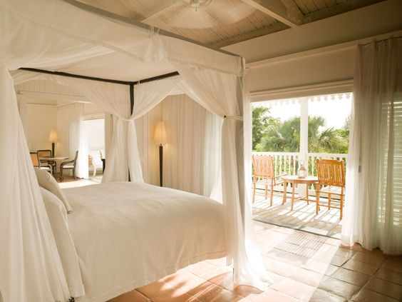 Take in the gentle island breeze either in your comfortable bedroom or the balcony's daybed in the COMO suites of Parrot Cay, Turks and Caicos.