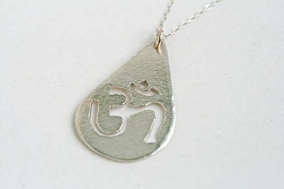 Om Necklace by Luscious Metals.  From the Divine Align collection- this collection is full of beautiful symbolism.  Wearing the pieces (like this OM) can help you manifest things in your life that you love.