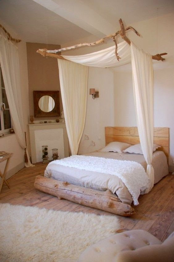 Bedroom with driftwood canopy and drift at the foot of the bed.  Rustic elegance.:
