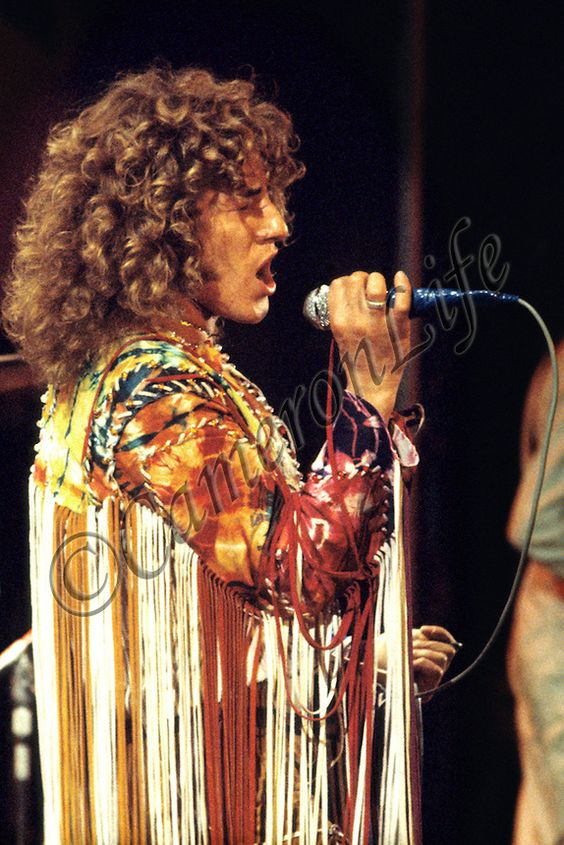"Roger Daltrey - The Who .-.Daltrey in his customary tassels was on top form. He worked his way through a marathon set that saw the sun come up on Sunday morning. The set included favourites like ""Tommy"", ""Shaking all Over"" and ""My Generation"". The crowd loved it."