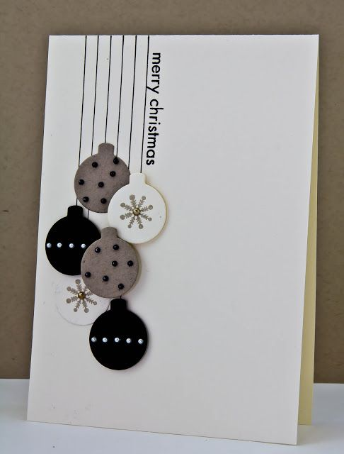 The straight lines and round ornaments in black, white and grey make a stunning handmade Christmas card.  If you prefer pops of color, change up the bling on the ornaments or the color of the sentiment.: