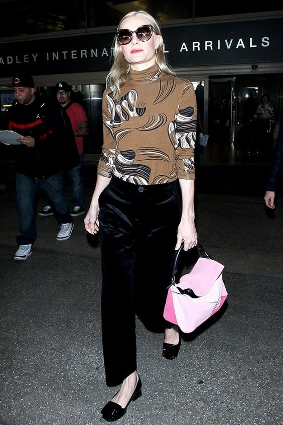 Kate Bosworth pairs a printed sweater with black pants, a Loewe tote and low heels