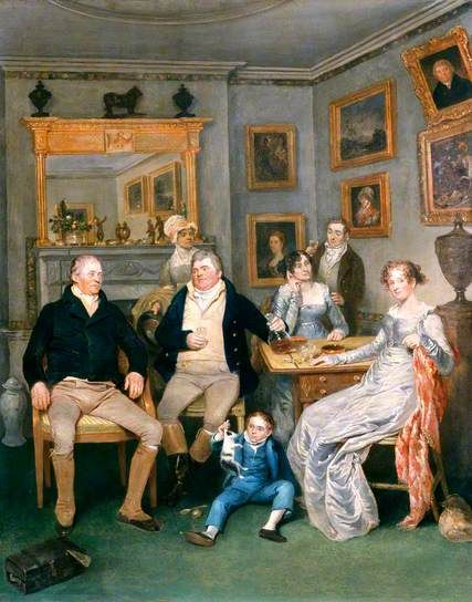 A Family Scene in a Domestic Interior c.1815-1820 possibly by John Partridge (British 1789-1872)....note the man on the left's suede gaiters, the mens fall-front breeches and the boys three-piece blue suit...interesting details of costume and interior, although a slightly awkward composition...