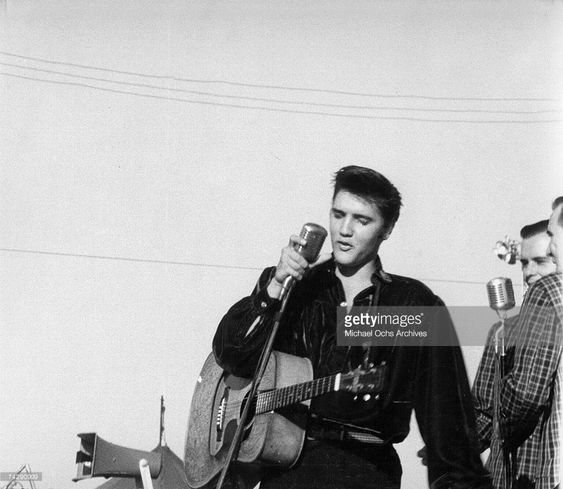 Rock and roll singer Elvis Presley performs outside to adoring fans on September 26, 1956 in his hometown of Tupelo, Mississippi. (Photo by Michael Ochs Archives/Getty Images)