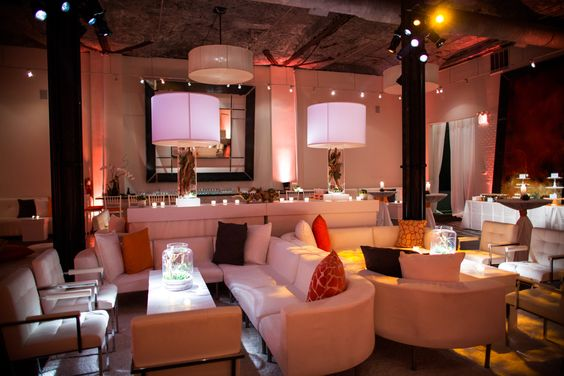 Party/dancefloor in separate room after dinner. Lounge seating. Orange hue...our own personal club!