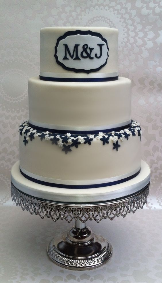 Wedding cake - Wedding caked based on brides dress and wedding colours