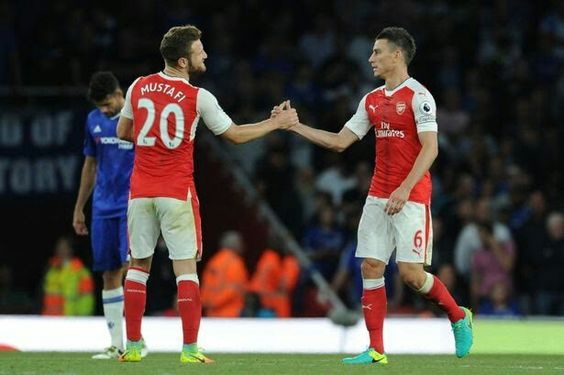 Mustafi and kosienly share a moment after thrashing chelsea 3-0