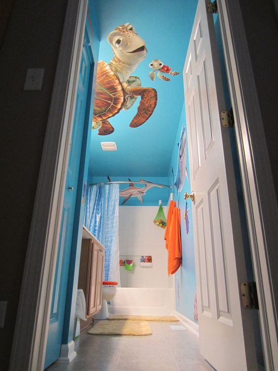 Super cute bathroom, featuring Nemo & Friends! SHOP http://www.fathead.com/disney/finding-nemo/nemo-friends-collection/ | DIY Home Decor On A Budget