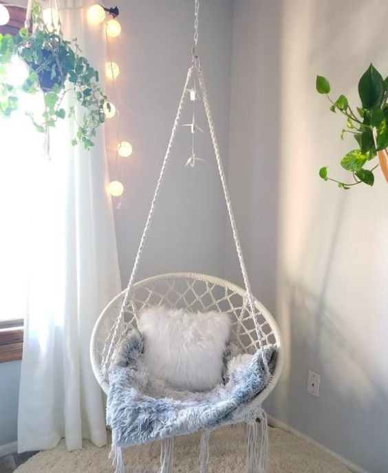 """Promising review: """"The chair looks fantastic hanging up! This chair is quite comfortable. The ropes are sturdy and good quality, better than expected for the price. Our installation included hanging it from a secured wooden block on the ceiling. The swing holds an average adult weight without breaking, so far. The ropes are thick, so I doubt they will break soon. Favorite chair in the house!"""" —oldmcconnefarmGet it from Amazon for $49.99."""