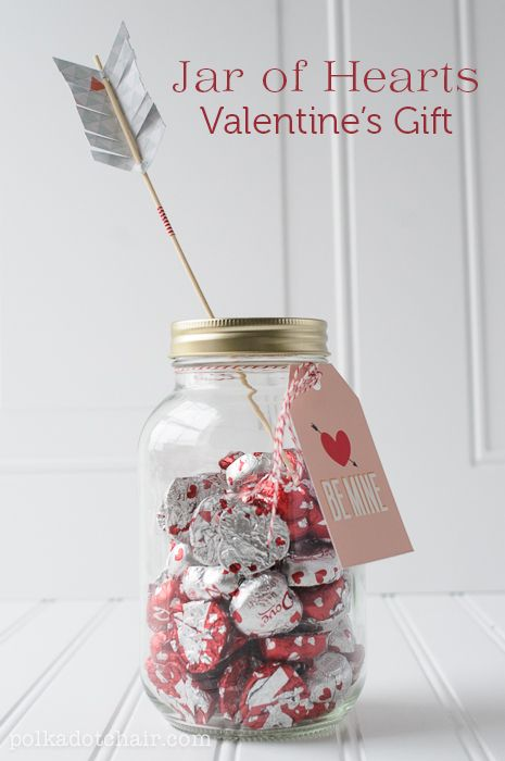 A mason jar of hearts struck by Cupid's bow - Valentine's Day gift - with free printable!