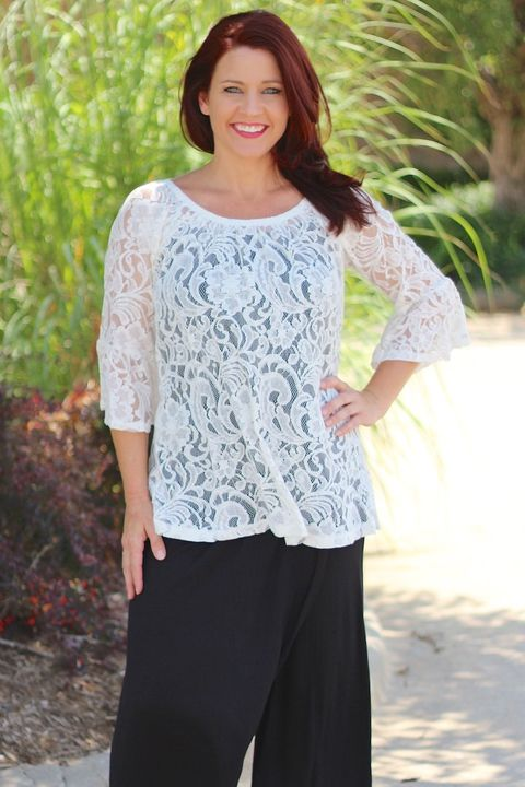 "Our Creme Full Lace Top with Bell Sleeves is made of 100% Polyester and measures approximately 29"" long from shoulder to hem.  This top is available in sizes Small, Medium, Large and X-Large."