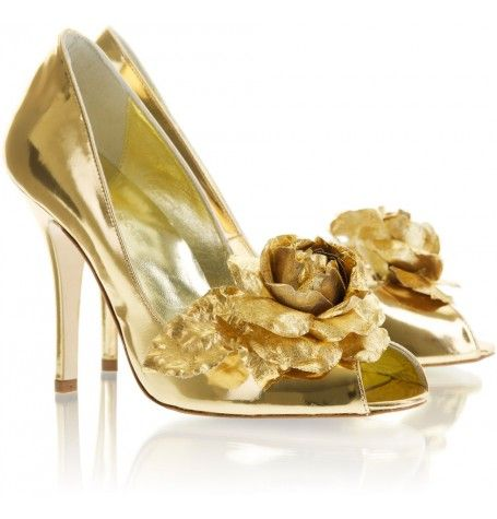 Image of Freya Rose Ennis with gold mirror leather and opulent gold rose detail