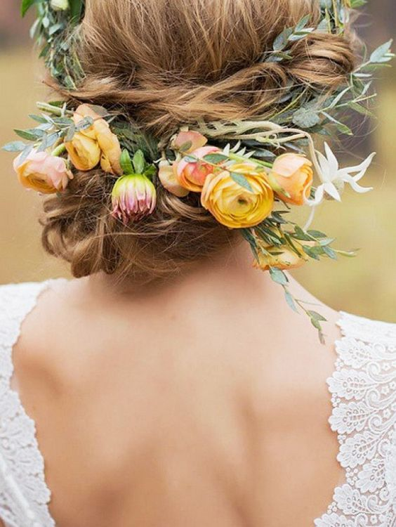 Breathtakingly beautiful floral crown for a boho-chic bride The Ranunculus is amazing and what ever the green foliage is, the small roundish shapes look great with the patterns sprigs of green. Perfect crown shape made by the sprigs. The peachy colour isn't my thing though: