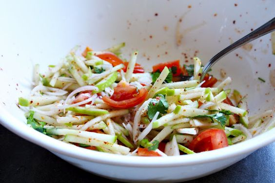 One medium Granny Smith or very firm and tart apple  One medium (50g) shallot  Two small tomatoes, cut into 1/4-inch dice  Lime juice, to taste  Fish sauce, to taste  Dried red pepper powder, to taste  About 2-3 tablespoons of chopped cilantro leaves