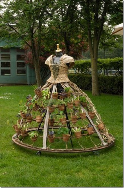 garden dress garden art. Casters on the hoop/base makes me think it's not meant for year round. Maybe a work-around to that, tho?
