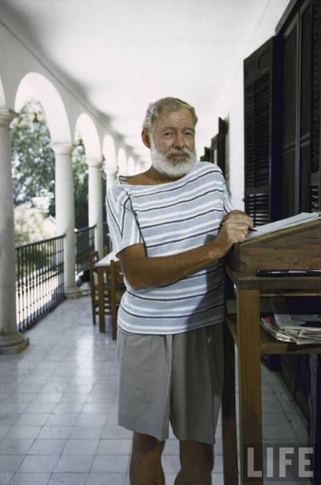 Ernest Hemingway at the standing desk on the balcony of Bill Davis's home near Malaga where he wrote 'The Dangerous Summer'.