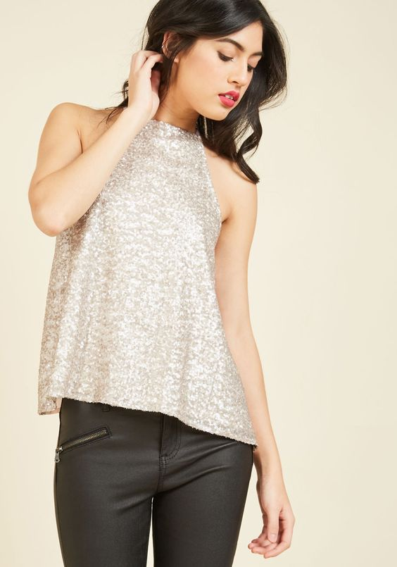 Embody exemplary elegance in this stunning sequined tank top! This high-neck top touts a chiffon back and a swingy silhouette that make your ensemble an inspiration to others.:
